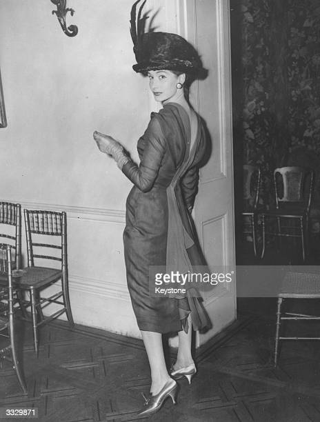 Model wearing a shaded chiffon sheath dress called 'My Green Lady' and an Edwardian-style hat at a show of dubutante fashions by Bellville et Cie in...