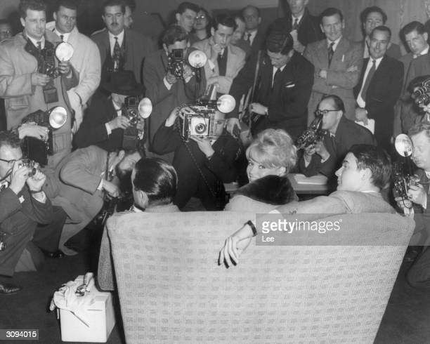 French actress Brigitte Bardot arrives at London Airport for the filming of 'Babette Goes To War' at the Royal Airforce Station in Abingdon
