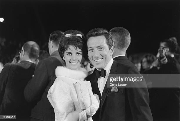 EXCLUSIVE American pop singer Andy Williams smiles with his wife French singer Claudine Longet while arriving at the Academy Awards Santa Monica...