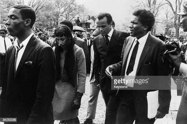 American calypso singer Harry Belafonte arriving at the funeral in Atlanta of civil rights activist Martin Luther King who was assassinated in...