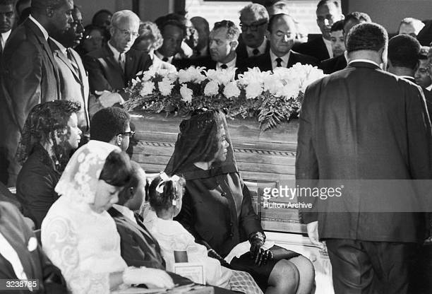 Coretta Scott King widow of Dr Martin Luther King Jr sits with their children beside his casket during his funeral at the Ebenezer Baptist Church...