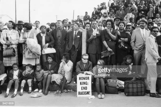 Mourners waiting for Dr Martin Luther King's funeral cortege to pass them outside Moorhouse College in Atlanta Georgia