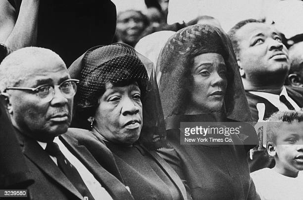 The parents and the widow of assassinated civil rights leader Dr Martin Luther King Jr listen to ceremonies at Morehouse College during a memorial...