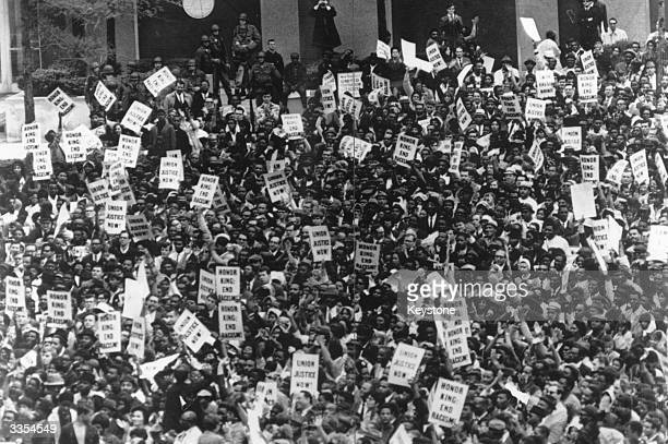 Thousands of people lining the streets of Atlanta Georgia for the funeral of Civil Rights leader Dr Martin Luther King Jnr who was assassinated by...