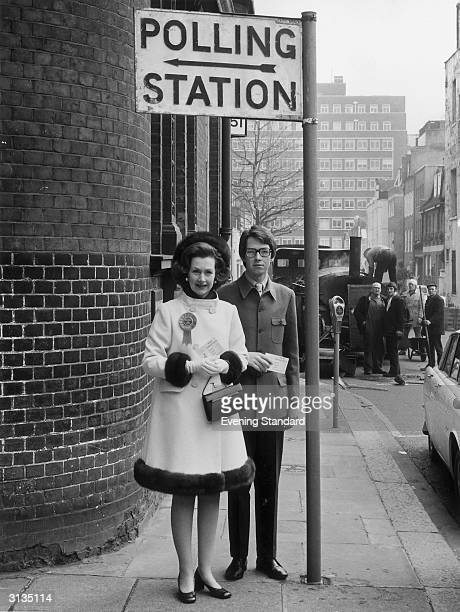 Lady Dartmouth later Raine Spencer with her son Rupert Legge at a polling station in Mayfair during the General Election
