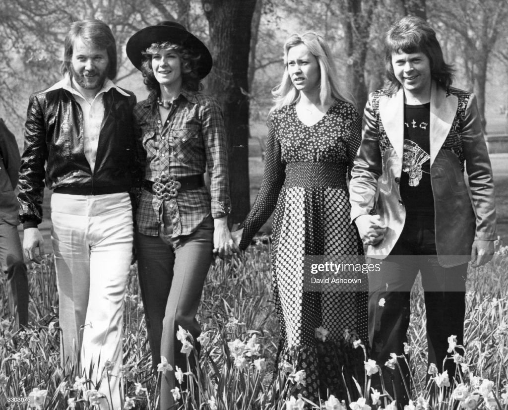 Swedish pop group Abba, winners of the 1974 Eurovision Song Contest at Brighton, strolling hand in hand amongst the daffodils in Hyde Park, London.