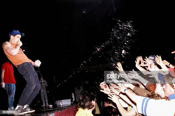 WORCESTER USA 9th APRIL AdRock from American hip hop group Beastie Boys sprays the contents of a can of Budweiser beer over members of the audience...