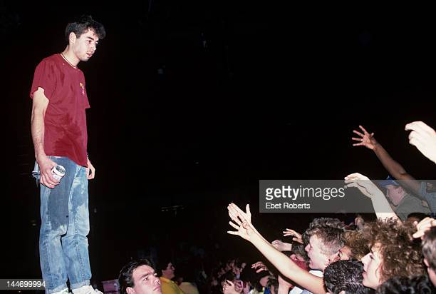 WORCESTER USA 9th APRIL MCA from American hip hop group Beastie Boys sprays the contents of a can of Budweiser beer over members of the audience from...