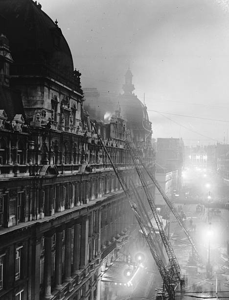 Firemen fighting the blaze at the Carlton Hotel, in...