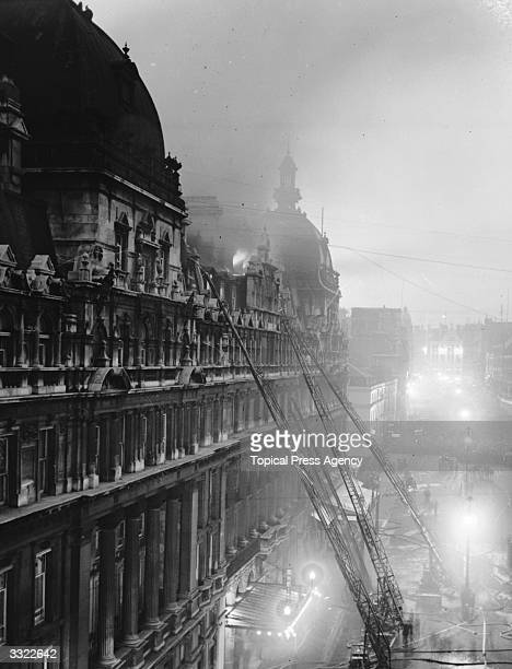 Firemen fighting the blaze at the Carlton Hotel in the Haymarket central London