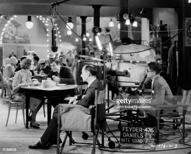 Swedish actress Greta Garbo films a cafe scene for the movie 'Anna Christie', directed by Clarence Brown and based on the play by Eugene O'Neill.