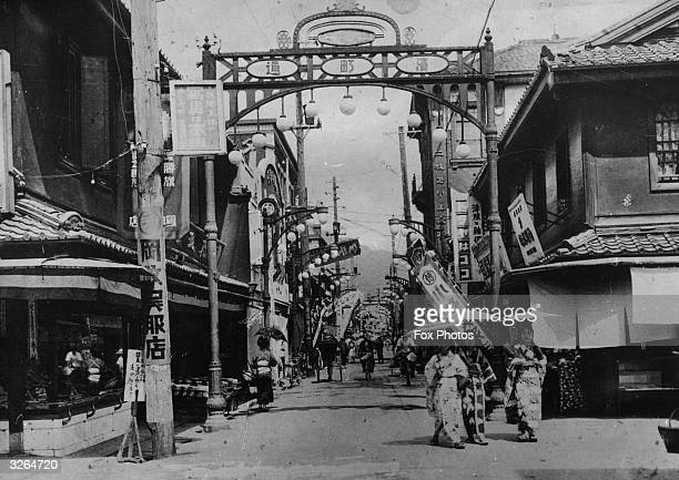 People promenading down a busy street in Nagasaki