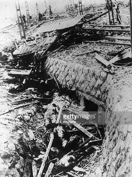 Victims of the atomic explosion in Nagasaki lie dead in a ditch after being thrown from the tram in which they were travelling
