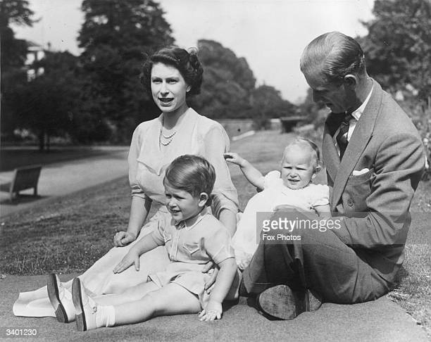 Princess Elizabeth and Prince Philip, Duke of Edinburgh with their two children, Prince Charles and Princess Anne in the grounds of Clarence House,...