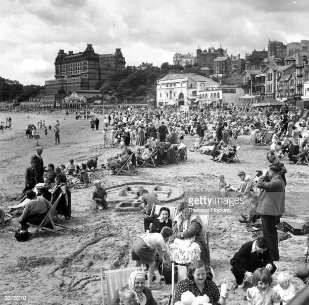 Holiday makers enjoying themselves on the South Bay Beach at Scarborough. Original Publication: Picture Post - 5997 - A Trip To Scarborough - pub....