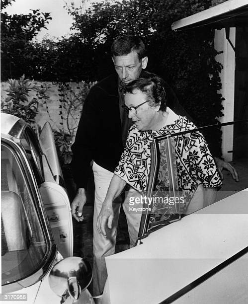 Marilyn Monroe's housekeeper Eunice Murray and handyman Norman Jeffries leaving the Monroe house after the film star's death