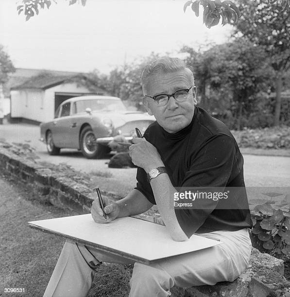 The Daily Express cartoonist, C R Giles, at his home.