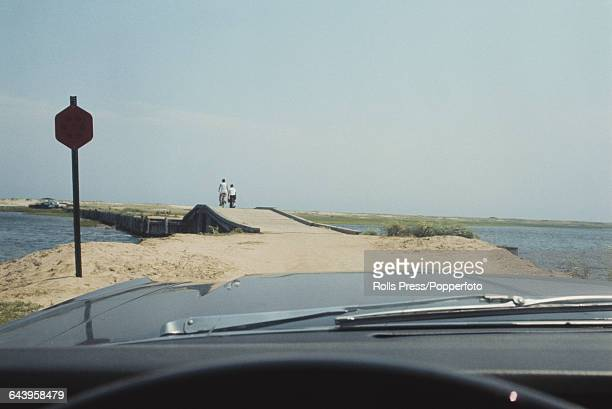 9th August 1969 view from the driver's seat of a car as it approaches Dike Bridge on Chappaquiddick Island near Edgartown Massachusetts the same...