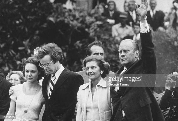 American president Gerald Ford waving goodbye as former President Richard Nixon's helicopter takes off from the White House on the day he resigned...
