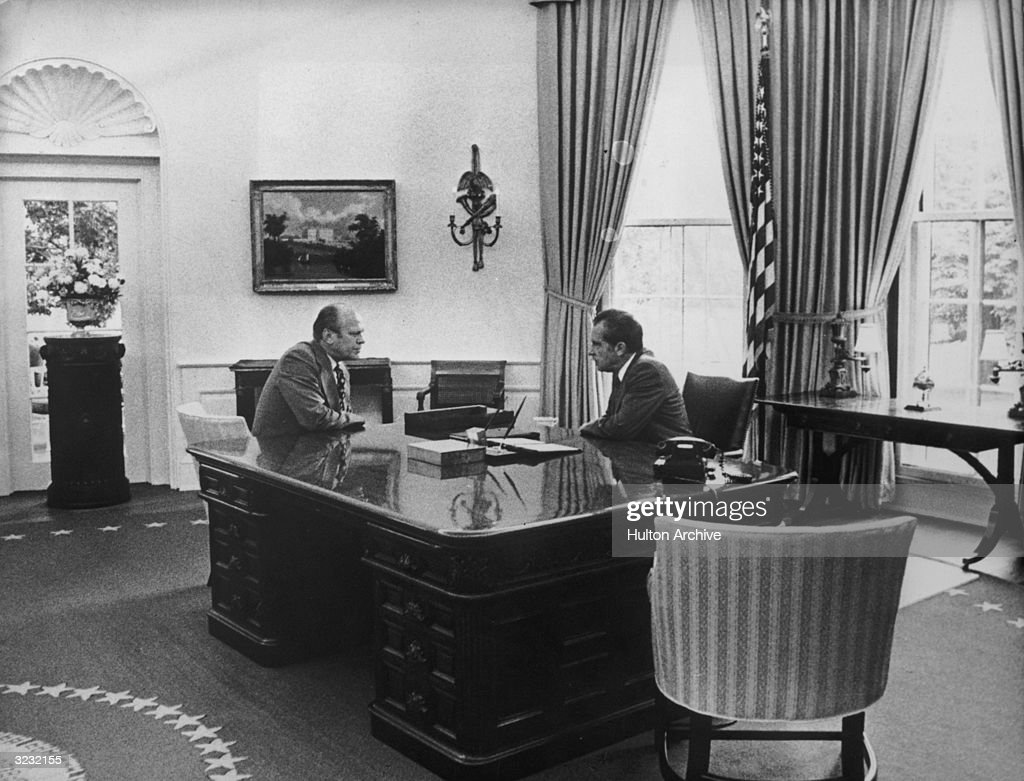 President Richard Nixon (R) and Vice President Gerald Ford face each other in the Oval Office on the day Nixon resigned, White House, Washington, DC.