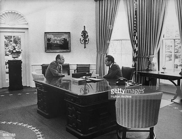 President Richard Nixon and Vice President Gerald Ford face each other in the Oval Office on the day Nixon resigned White House Washington DC