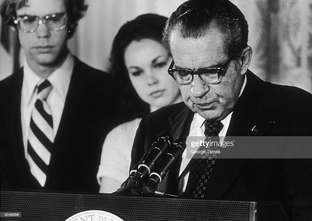 U.S. President Richard Nixon looks down as stands at a podium, reading a farewell speech to his staff following his resignation, the White House, Washington, D.C.