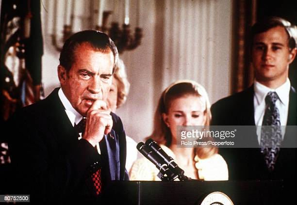 9th AUGUST 1974 Washington D C USA President Richard Nixon of the United States holds back a tear as he makes his resignation speech alongside his...