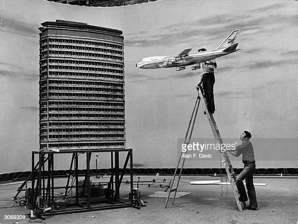 Film technicians at Pinewood Studios set up a miniature air crash sequence for the Jack Gold film 'The Medusa Touch' using scale models of a Boeing...