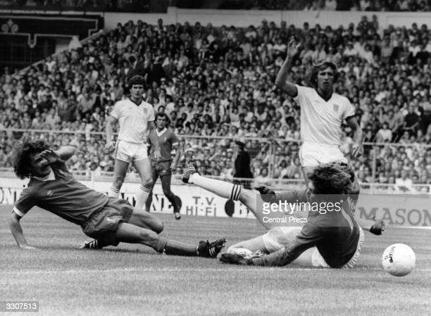 Terry McDermott of Liverpool slides the ball wide past West Ham United's goalkeeper Phil Parkes during the Charity Shield match at Wembley