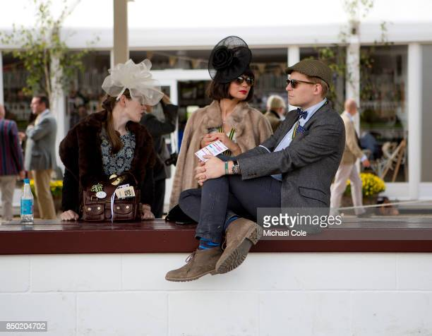 Couple relaxing in the Pit Lane during the racing at Goodwood on September 9th 2017 in Chichester England