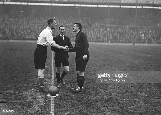 Bower of England shakes hands with Belgium's captain Swaertenbroecks as Welsh referee J R Macfarlane looks on before the start of the international...