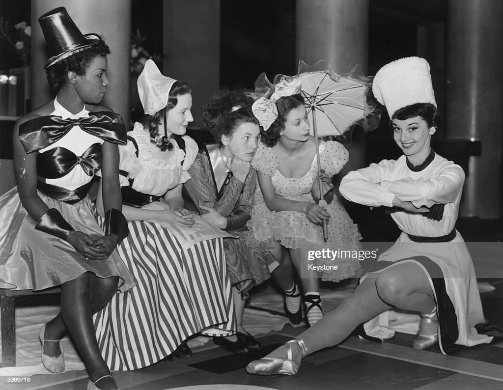 Audrey Hepburn (1929 - 1993) with the cast of a Christmas Party revue at the Cambridge Theatre. The play for children stars Hepburn as a cossack, along side Cherry Adele, Jean Baylis, Gillian Moran, and Sylvia Russell, who portray various other dolls.
