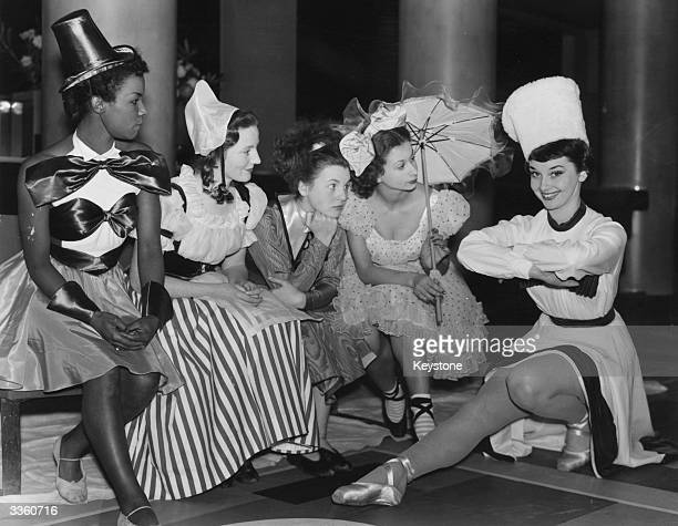 Audrey Hepburn with the cast of a Christmas Party revue at the Cambridge Theatre The play for children stars Hepburn as a cossack along side Cherry...