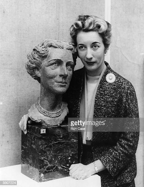 Sculptress Eva Castle with her bust of the Duchess of Kent at the private view of the third Annual Exhibition of the Society of Portrait Sculptors at...