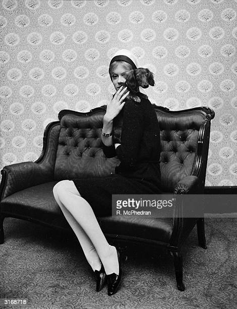 Fashion model Caroline Graham with her pet dog Pucci.