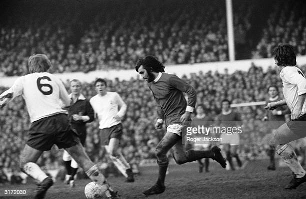 Manchester United's George Best confounds his opponents with one of his trade mark mazy runs