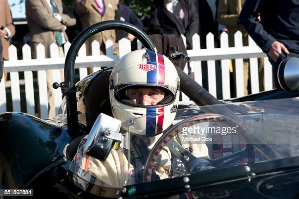 Entrant driver Steve BoultbeeBrooks sitting in his 1958 ListerJaguar 'Flat Iron' in the Assembly Area for the Sussex Trophy at Goodwood on September...