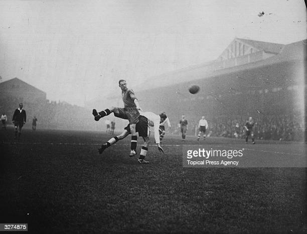 Fulham's centre forward Perry is robbed of the ball by Chester Bury's rightback during a match at Craven Cottage Fulham