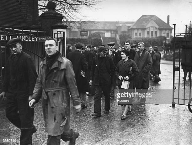 A day in the life of Mrs G Smith as she arrives for work in a munitions factory alongside the male workers