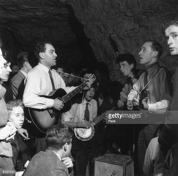 Members of a jazz band playing during a party held in Chislehurst Caves in Kent