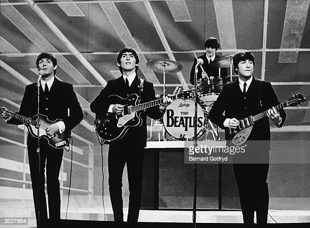 British rock group The Beatles perform in a still from the television series, 'The Ed Sullivan Show,' New York City, L-R: Paul McCartney, George...