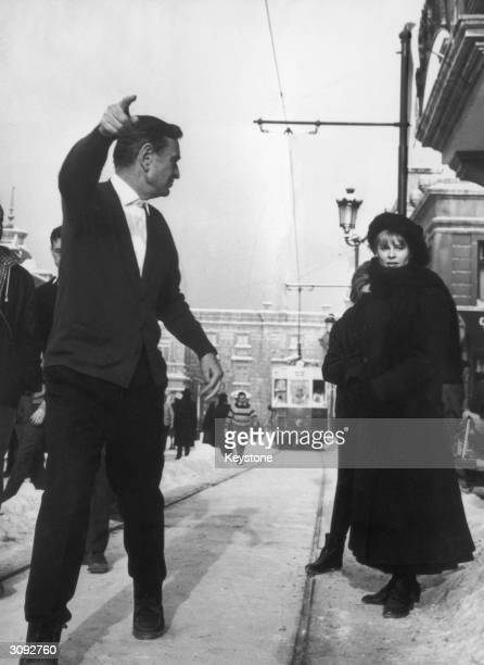 British film director David Lean explaining a scene to Julie Christie on the set of 'Doctor Zhivago'
