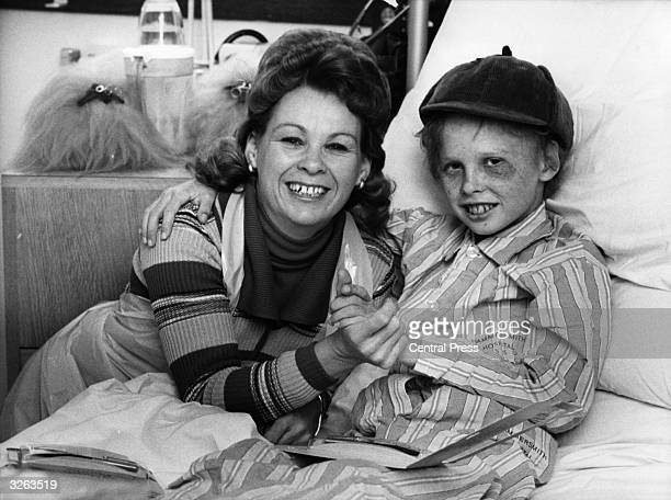Mrs Dewhurst from New Zealand with her son Leslie aged 11 who is in bed at Hammersmith Hospital recovering from a bone marrow operation