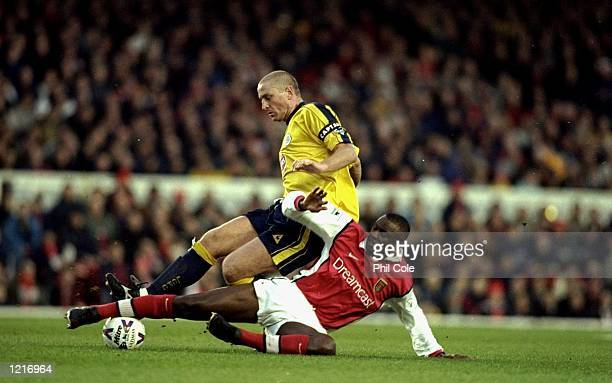 Patrick Vieira of Arsenal and Matt Elliot of Leicester in action in the FA Cup 4th Round Match played at Highbury in London. The match ended 0-0 \...