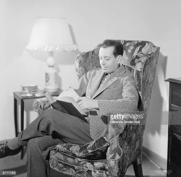 Cole Porter one of the outstanding composers and lyricists of 20th century musical theatre reading a book