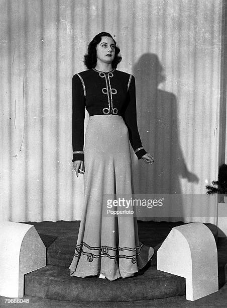 9th January 1941 London England A Dinner Gown and middayjacket in two shades of blue embroidered with silver bugles modelled in London prior to...