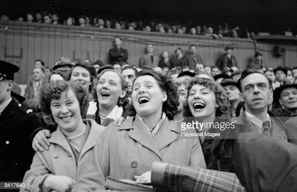Enthusiastic Bristol Rovers supporters cheer on their team Original Publication Picture Post 6864 Bristol Rovers No Buy No Sale pub 1954