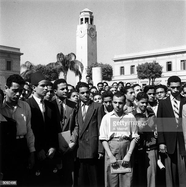 Students at Fuad University in Giza stand to observe five minutes silence for the martyrs of the Suez conflict Original Publication Picture Post 6875...