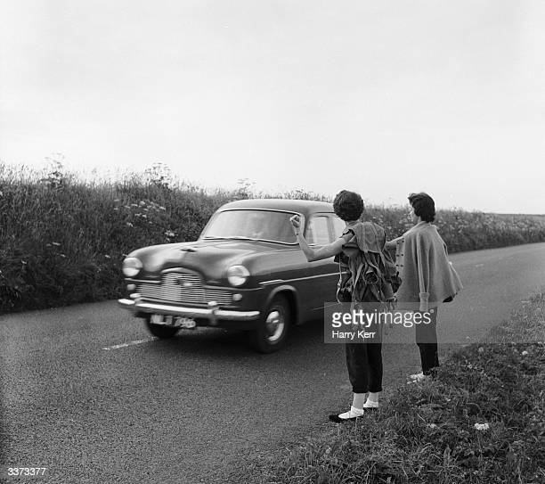 Marilyn Ridge and Lyn Connelly hitchhike through the lanes of Cornwall armed with a Geiger counter hoping to strike a rich seam of Uranium