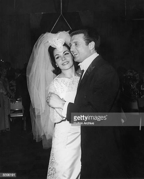 American actor and singer Annette Funicello smiles while dancing with her husband agent Jack Gilardi at their wedding reception She wears a wedding...